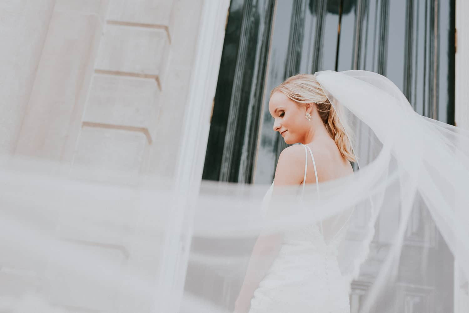 Bride with long veil at Old Main