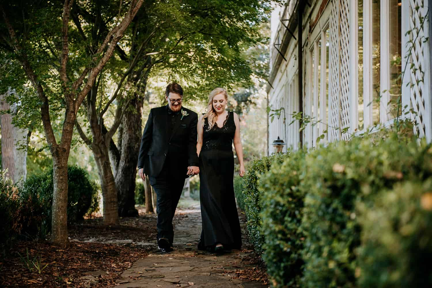 Bride and groom walking holding hands at Crescent Hotel in Eureka Springs