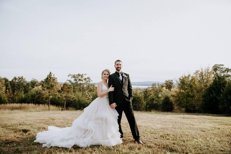 Bride and groom posing at Cabin Creek Lookout