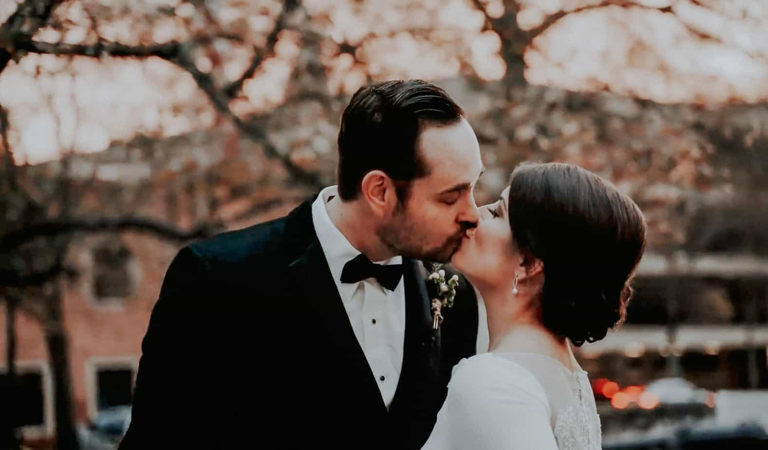 bride and groom kissing in Little Rock