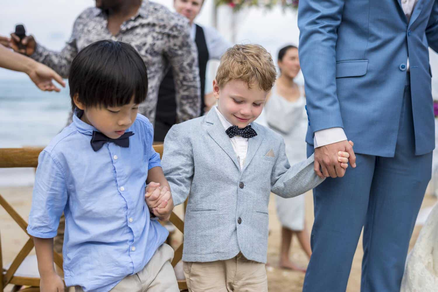 Two young boys at wedding ceremony